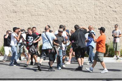 Britney in a scrum of paparazzi Oct 2009.