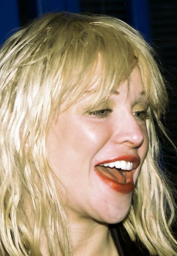 Courtney Love arrives at Heathrow airport, London, Feb. 4, 2003 to perform a charity concert. (AP Photo/Max Nash)
